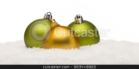 Green and Yellow Christmas Ornaments on Snow Isolated on White stock photo, Beautiful Green and Yellow Christmas Ornaments on Snow Flakes Isolated on a White Background. by Andy Dean