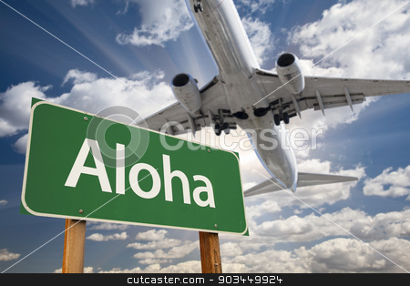 Aloha Green Road Sign and Airplane Above stock photo, Aloha Green Road Sign and Airplane Above with Dramatic Blue Sky and Clouds. by Andy Dean