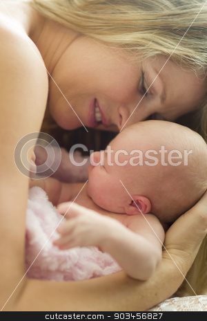 Young Beautiful Mother Holding Her Precious Newborn Baby Girl stock photo, Young Caucasian Beautiful Mother Holding Her Precious Newborn Baby Girl. by Andy Dean