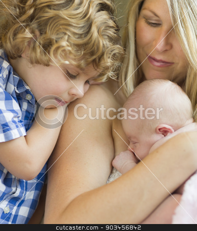 Young Mother Holds Newborn Baby Girl as Brother Looks On stock photo, Beautiful Young Mother Holds Precious Newborn Baby Girl as Brother Looks On. by Andy Dean