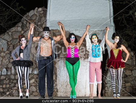 Happy Cirque Clowns on Stage stock photo, Group of happy cirque clowns holding hands by Scott Griessel