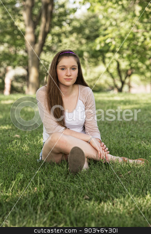 Calm Teen Sitting stock photo, Calm teenage female sitting on grass outdoors by Scott Griessel