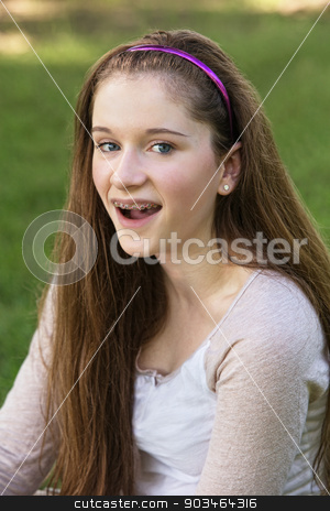 Teen with Braces Laughing stock photo, Single laughing teenage female with braces on teeth by Scott Griessel