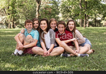 Happy Youth on Lawn stock photo, Happy group of young friends sitting on grass by Scott Griessel