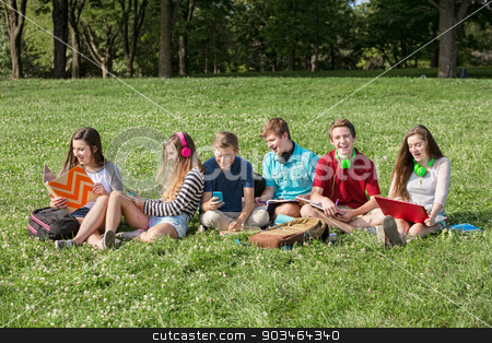 Cheerful Students Outdoors stock photo, Laughing group of male and female students outdoors by Scott Griessel