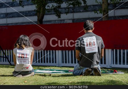 Two Young People at View Section of AIDS Quilt stock photo, TUCSON, AZ/USA - OCTOBER 12:  Unidentified people view section of AIDS quilt on October 12, 2014 in Tucson, Arizona, USA. by Scott Griessel