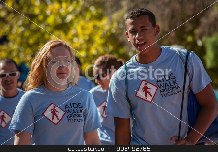 Two Young People at AIDSwalk stock photo, TUCSON, AZ/USA - OCTOBER 12: Unidentified participants in AIDSwalk on October 12, 2014 in Tucson, Arizona, USA. by Scott Griessel