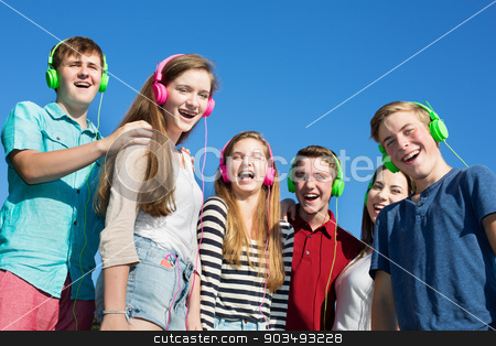 Six Happy Teens Laughing stock photo, Group of six happy teenagers laughing outdoors by Scott Griessel
