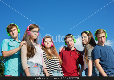 Six Serious Teenagers stock photo, Group of frowning European teenagers with headphones by Scott Griessel
