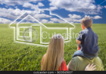 Young Family in Grass Field with Ghosted House in Front stock photo, Young Family in Grass Field with Ghosted House In Front of Them. by Andy Dean