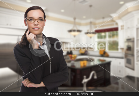 Mixed Race Young Woman Standing in Beautiful Custom Kitchen stock photo, Attractive Mixed Race Young Woman Standing in Beautiful Custom Kitchen. by Andy Dean