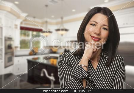 Hispanic Woman Standing in Beautiful Custom Kitchen stock photo, Attractive Hispanic Woman Standing in Beautiful Custom Kitchen. by Andy Dean