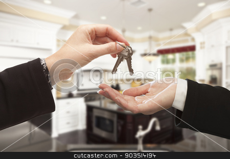 Handing Over New House Keys Inside Beautiful Home stock photo, Handing Over New House Keys Inside Beautiful Custom Built Home. by Andy Dean