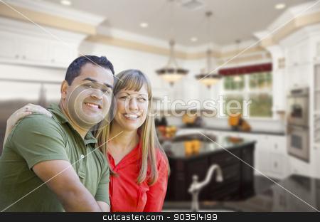 Mixed Race Couple Inside Beautiful Custom Kitchen stock photo, Happy Mixed Race Couple Inside Beautiful Custom Kitchen. by Andy Dean