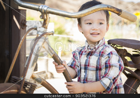 Mixed Race Young Boy Having Fun on the Bicycle stock photo, Cute Mixed Race Young Boy Having Fun on the Bicycle. by Andy Dean