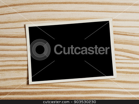 Old photograph. stock photo, Old blank photograph on wooden table. by Pablo Caridad