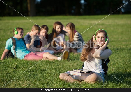 Singing Student stock photo, Cute singing female student with group outdoors by Scott Griessel