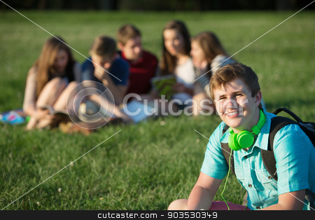 Smiling Teen Student stock photo, Smiling teen student with earphones sitting outdoors by Scott Griessel