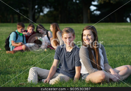 Two Happy Teen Friends stock photo, Two happy teenage male and female friends sitting outdoors by Scott Griessel