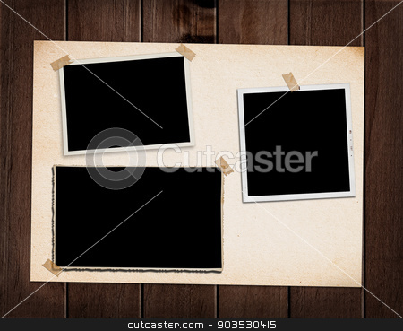 Old photo album.  stock photo, Vintage photo album with three old photographs. by Pablo Caridad