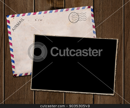 Old  photo and envelope. stock photo, Old photo and envelope on wooden table. by Pablo Caridad