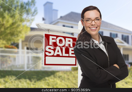 Young Woman in Front of House and Sale Sign stock photo, Attractive Mixed Race Woman in Front of House and For Sale Real Estate Sign. by Andy Dean