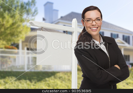 Woman In Front of House and Blank Real Estate Sign stock photo, Attractive Serious Mixed Race Woman In Front of House and Blank Real Estate Sign. by Andy Dean