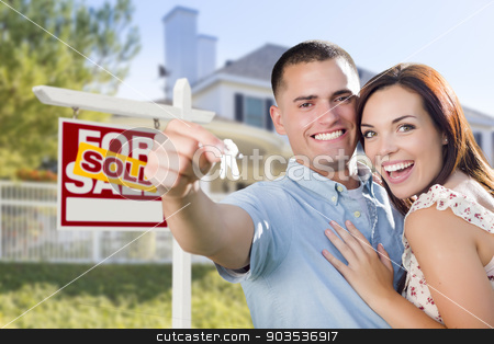 Military Couple In Front of Home, House Keys and Sign stock photo, Mixed Race Excited Military Couple In Front of New Home with New House Keys and Sold Real Estate Sign Outside. by Andy Dean