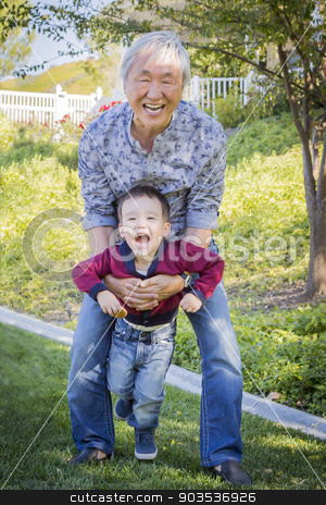 Chinese Grandpa Having Fun with His Mixed Race Grandson Outside stock photo, Happy Chinese Grandpa Having Fun with His Mixed Race Grandson Outside. by Andy Dean