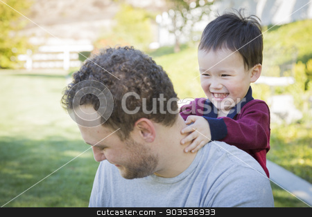 Caucasian Father Having Fun with His Mixed Race Baby Son stock photo, Happy Caucasian Father Having Fun with His Mixed Race Baby Son. by Andy Dean