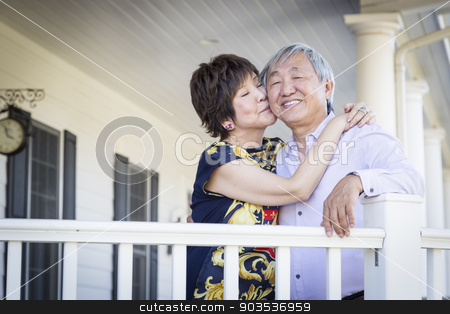 Attractive Chinese Couple Enjoying Their House stock photo, Attractive Happy Chinese Couple Enjoying Their House Outside. by Andy Dean