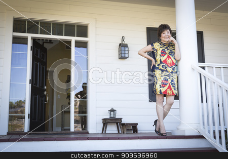 Attractive Chinese Woman On Her Front Porch stock photo, Happy Attractive Chinese Woman On Her Front Porch. by Andy Dean