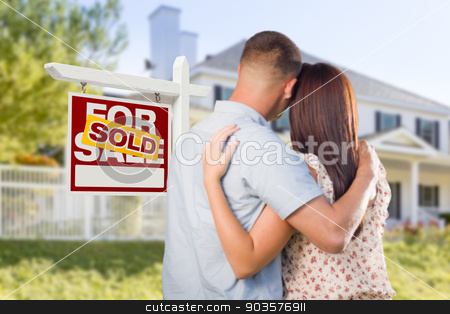 Sold For Sale Sign with Military Couple Looking at House stock photo, Sold For Sale Real Estate Sign and Affectionate Military Couple Looking at Nice New House. by Andy Dean