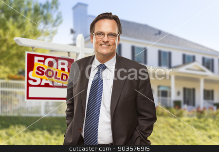 Real Estate Agent in Front of Sold Sign and House stock photo, Male Real Estate Agent in Front of Sold Home For Sale Sign and House. by Andy Dean