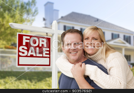 Couple in Front of New House and Real Estate Sign stock photo, Affectionate Happy Couple in Front of New House and For Sale Real Estate Sign. by Andy Dean