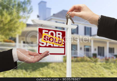 Sold Sign and Agent Handing Over Keys to New Home stock photo, Agent Handing Over Keys to a New Home with Sold Real Estate Sign and House in the Background. by Andy Dean