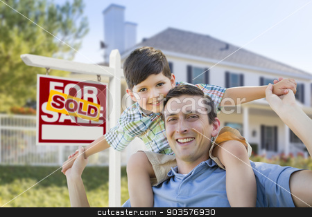 Mixed Race Father, Son Piggyback, Front of House, Sold Sign stock photo, Mixed Race Father and Son Celebrating with a Piggyback in Front of House and Sold Real Estate Sign. by Andy Dean