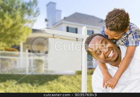 African American Father and Mixed Race Son, Blank Sign, House stock photo, Happy African American Father and Mixed Race Son In Front of Blank Real Estate Sign and New House. by Andy Dean