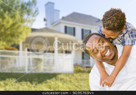 African American Father and Mixed Race Son, House Behind stock photo, Happy Playful African American Father and Mixed Race Son In Front of House. by Andy Dean