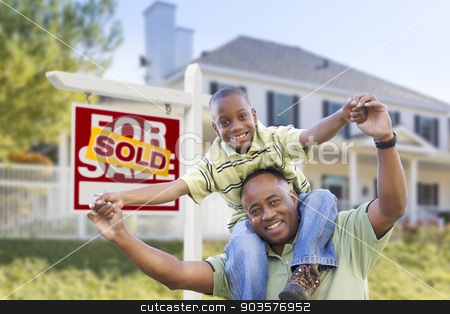 African American Father and Son, Sold Sign and Home stock photo, Happy African American Father and Son in Front of Home and Sold For Sale Real Estate Sign. by Andy Dean