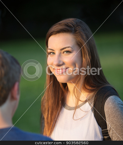 Cute Teen Girl with Friends stock photo, Cute smiling Caucasian female student with friends by Scott Griessel