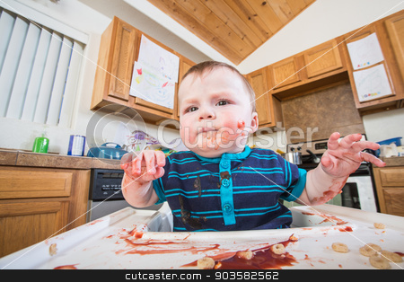Grumpy Child Eats stock photo, A grumpy child eats breakfast in the kitchen by Scott Griessel
