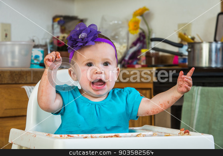 Baby Has a Tantrum stock photo, A baby girl throws a tantrum in the kitchen by Scott Griessel