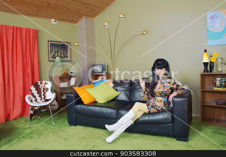 Cute Woman on Sofa stock photo, Cute mature retro fashion woman holding sunglasses by Scott Griessel