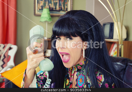 Woman Yelling at Phone stock photo, Woman yelling into phone with bad connection by Scott Griessel