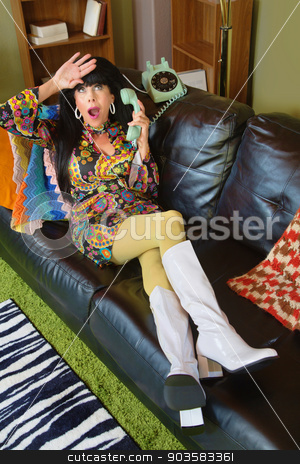 Dramatic Woman on Phone stock photo, Dramatic lay in 1960s style sitting on sofa with telephone by Scott Griessel