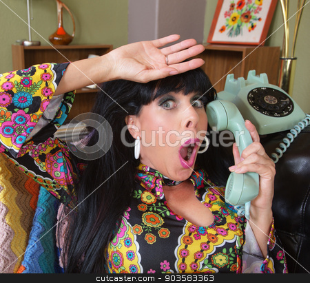 Relieved Lady on Telephone stock photo, Relieved woman in paisley on rotary telephone by Scott Griessel