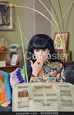 Shocked Woman Watching TV stock photo, Shocked woman with hand on mouth watching television by Scott Griessel