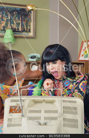 Laughing Friends Pointing at Television stock photo, Laughing 1960s women pointing and laughing at television by Scott Griessel