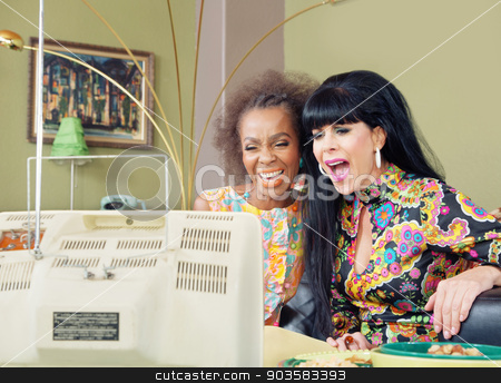 Gorgeous Female Pair Laughing at TV stock photo, Pair of gorgeous woman enjoying television together by Scott Griessel